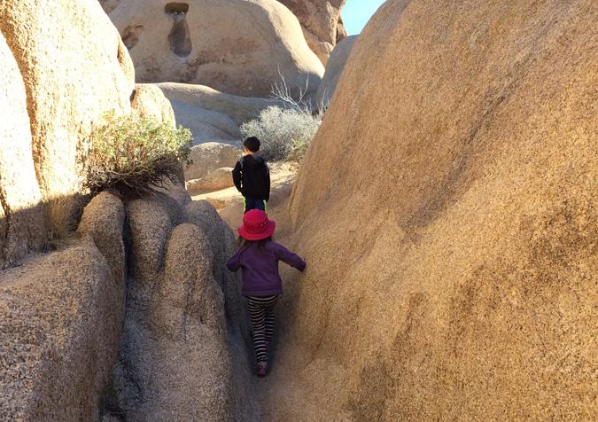 Squeezing through boulders near Jumbo Rocks